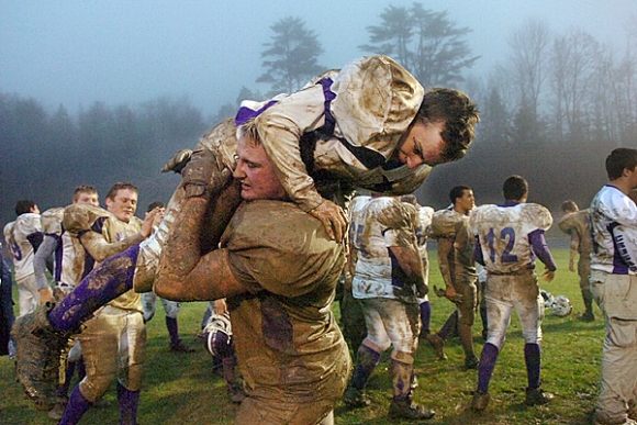 Brother Dan getting hoisted after the Eastern Maine title game, 2008. Photo from the Bangor Daily News.
